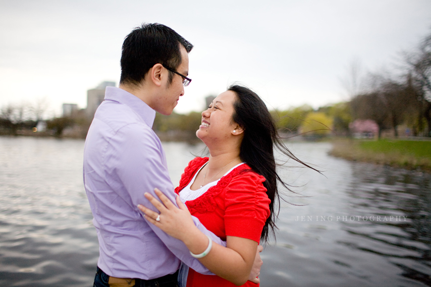 Engagement session on the Charles River - Couple on dock