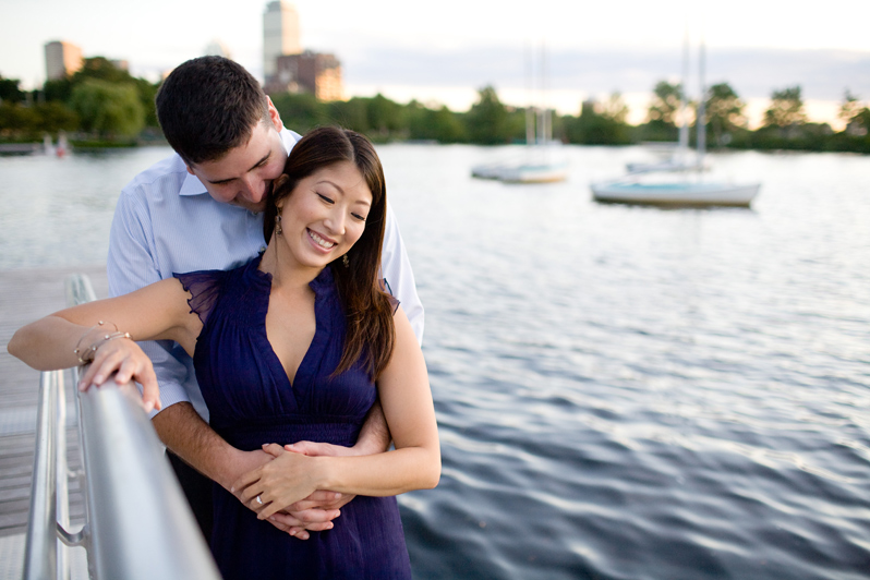 Charles River engagement photography - couple with boats