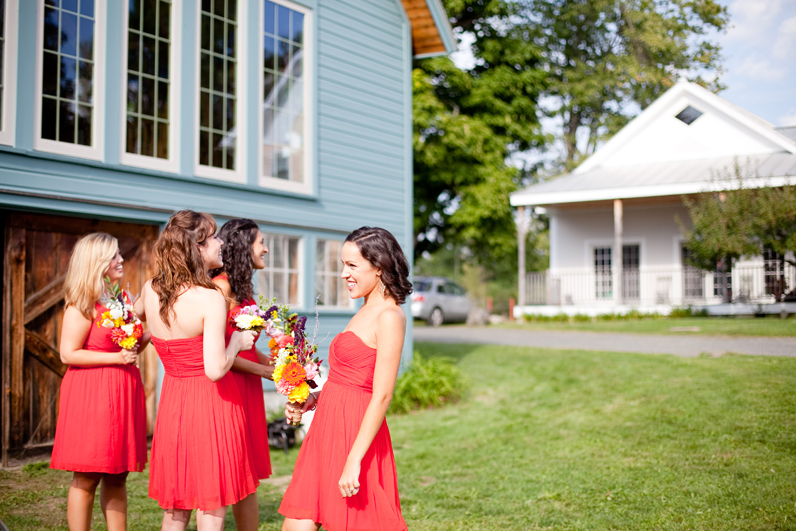 red bridesmaids dresses at a farm wedding