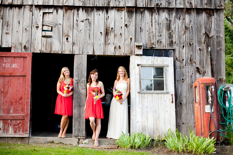 bride and bridesmaid in barn