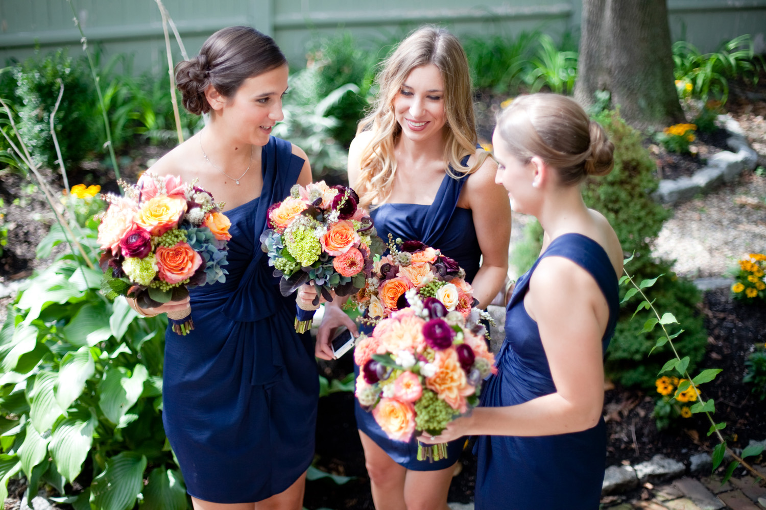 navy bridesmaids with fall floral bouquet