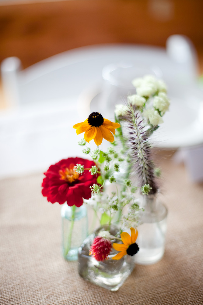 diy floral arrangements at rustic wedding